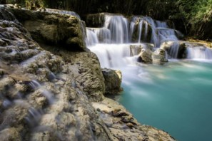Color photo of Kuang Xi waterfall near Luang Prabang, Laos