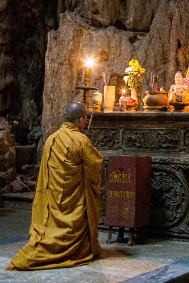 monk praying in marble mountain
