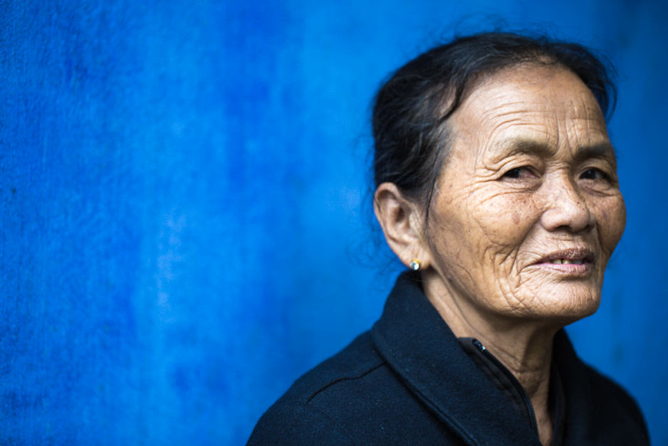 Vietnamese woman in front of a blue wall