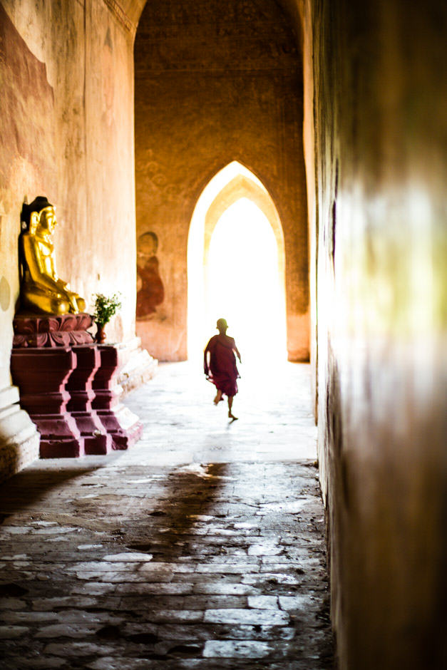 Mini monk running in a temple in Bagan