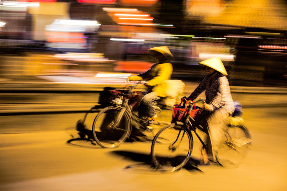 Panned photo of bicycle riders in Vietnam