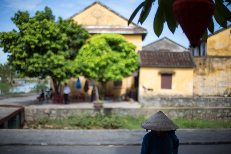 Woman with a hat in Hoi An streets