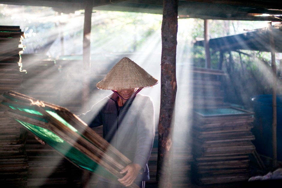 Vietnamese woman working in a steamy place
