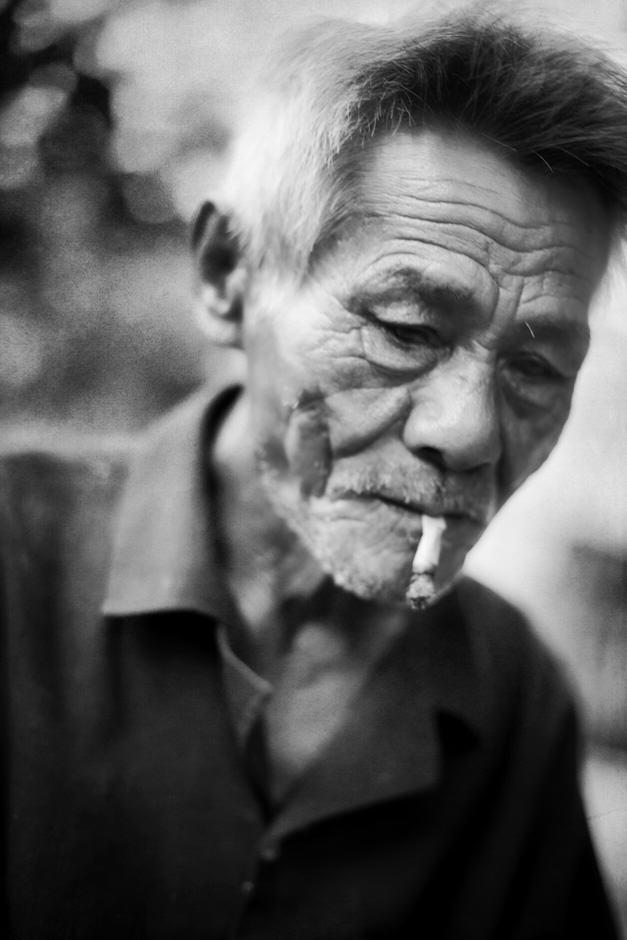black and white portrait of a Vietnamese man