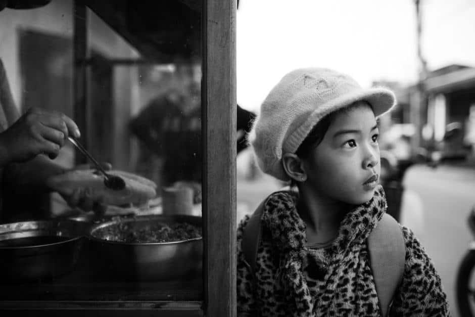 Vietnamese girl at a sandwich stall near Hoi An
