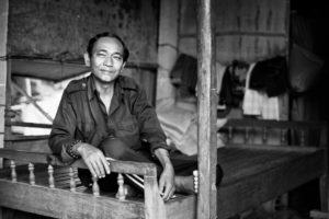 Vietnamese man in his house