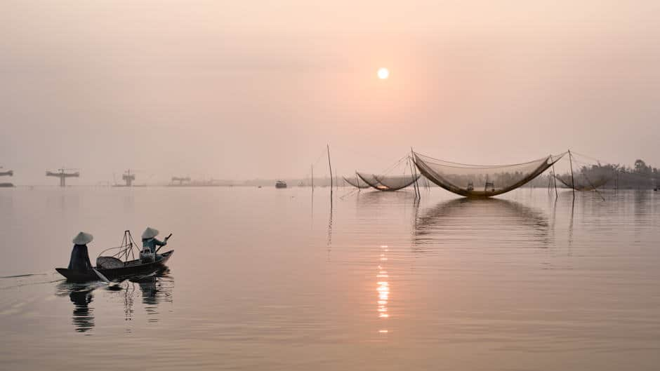 Boat on a river in Vietnam at sunrise