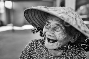 Old Vietnamese woman laughing