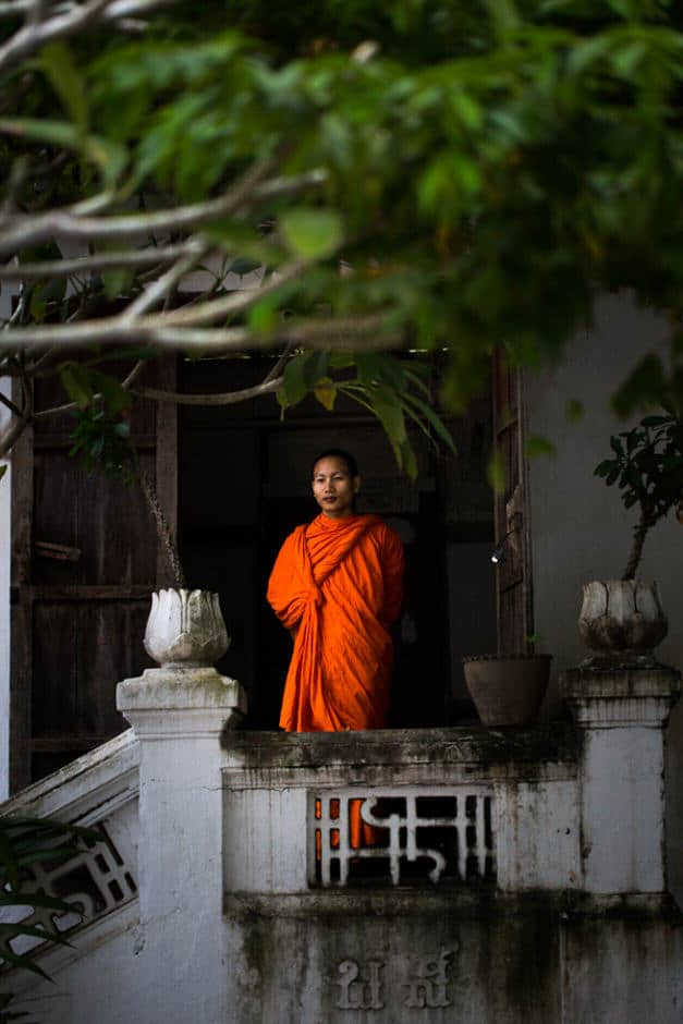 A monk looking outside a pagoda in Luang Prabang, Laos.