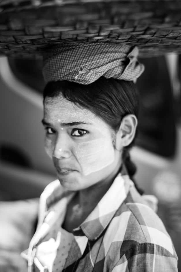 Burmese woman carrying fruits on her head, Mandalay