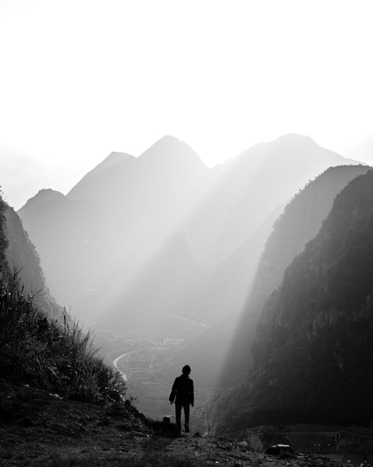 Hmong boy looking at the mountains of Ha Giang, Vietnam.