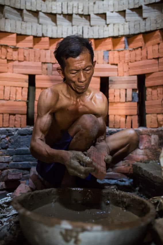 Man working in a brick factory in Vietnam