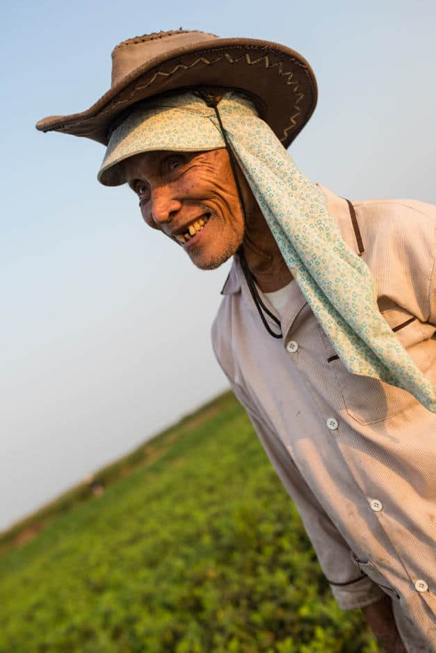 Old man from Vietnam portrait in a peanut field
