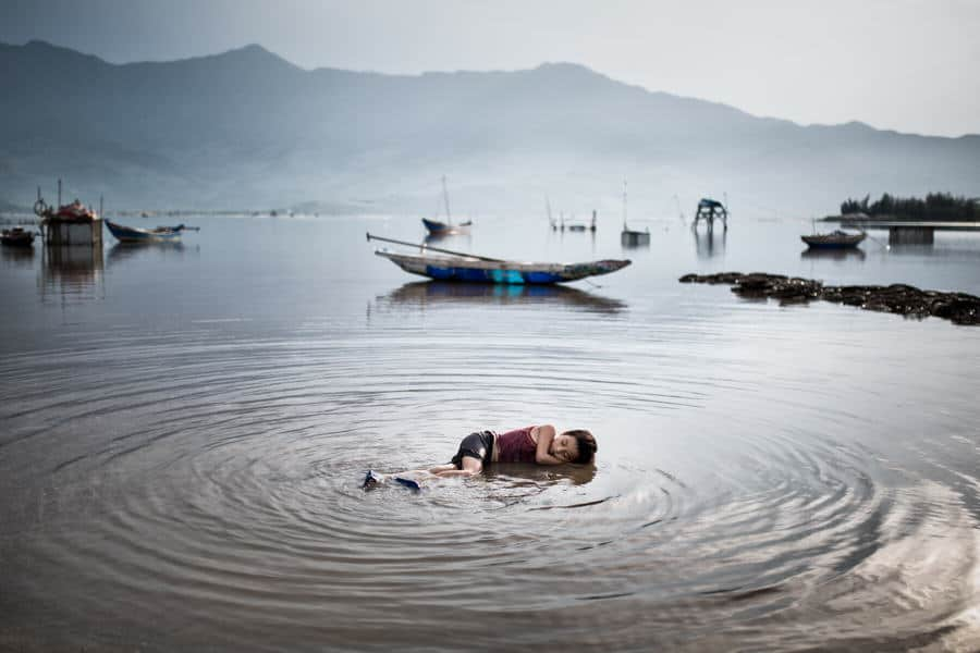 Boy laying down in the water