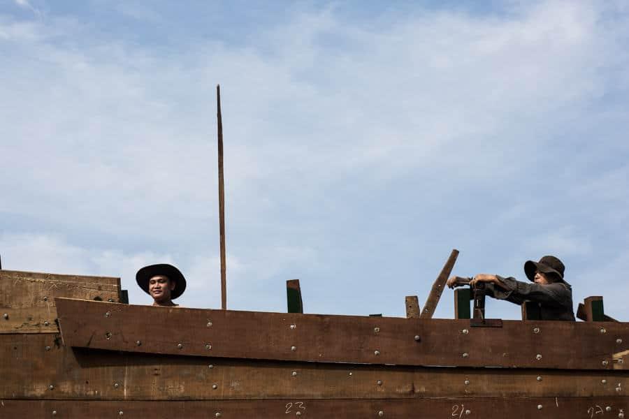 men building a ship in Vietnam