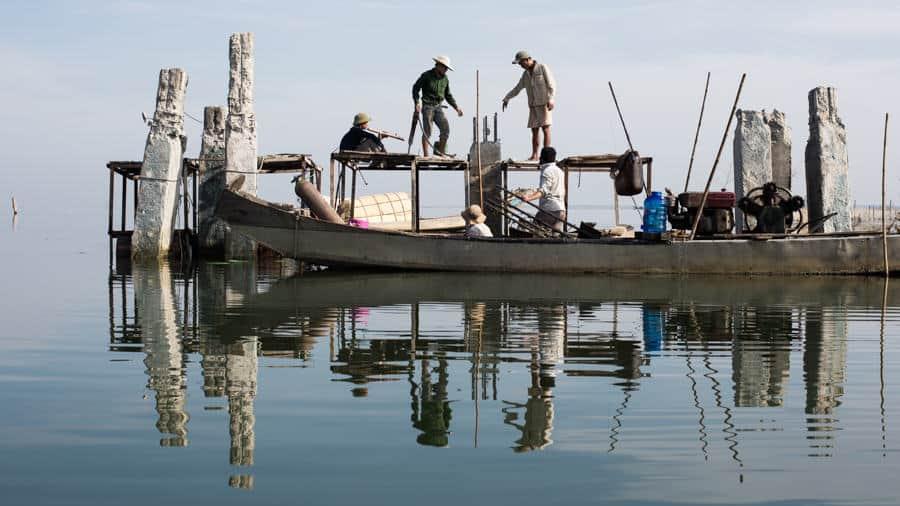 men working on a lagoon