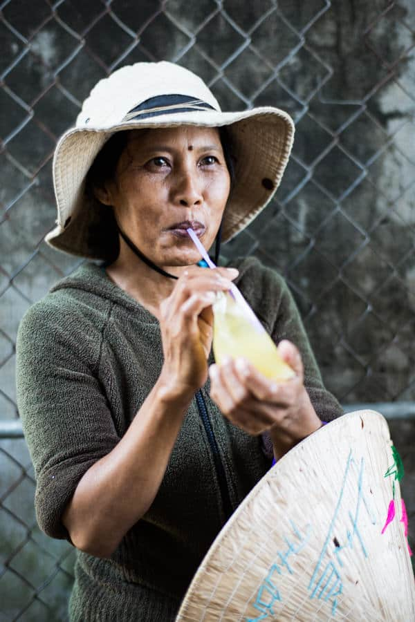 woman drinking sugar cane juice