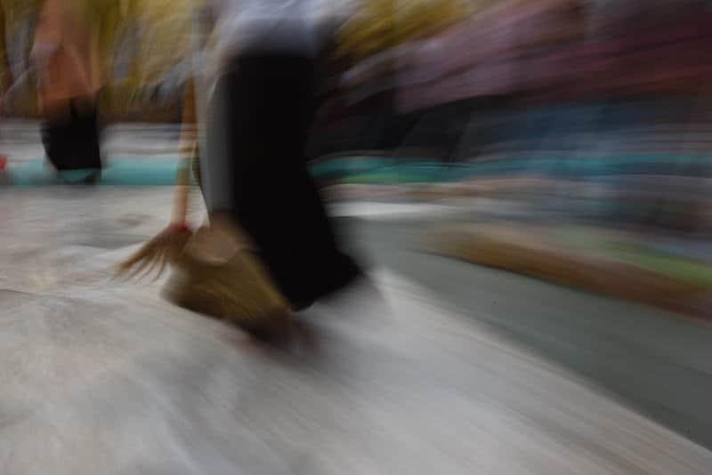 A blurry photo of people brooming Shwedagon pagoda