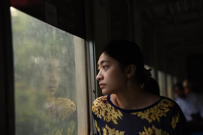 Asian girl in a train in Myanmar