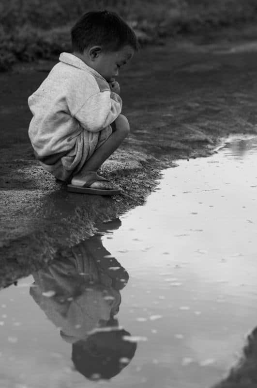 reflection of a young Lao boy