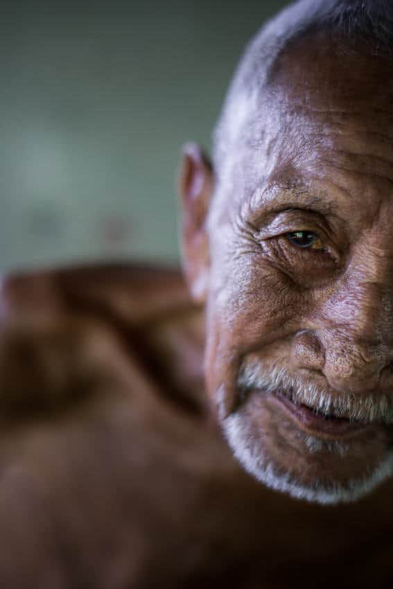 A close up portrait of an old man in Laos