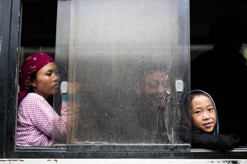A Hmong boy sitting on a bus in Vietnam