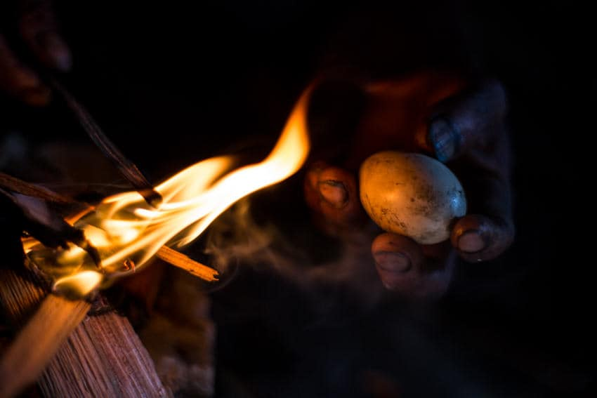 Shaman burning an egg to read the spirits' signs