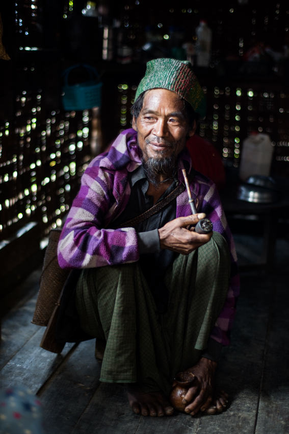 Burmese man smoking a pipe