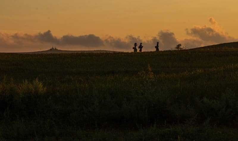 Farmers walking home at sunset