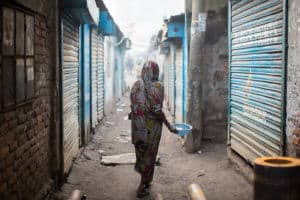 Bengali woman walking the streets of South Dhaka