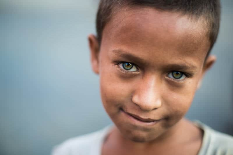 A young Bengali boy with green eyes