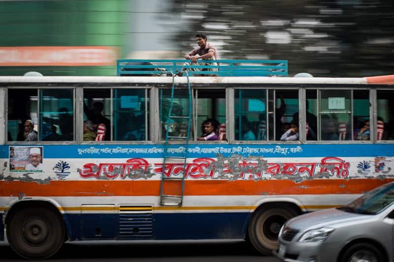 man sitting on a bus in Bangladesh