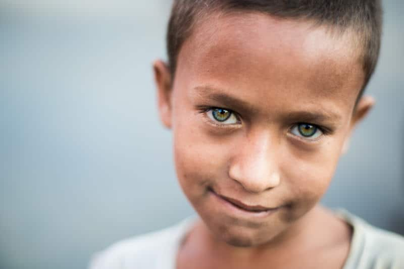 Portrait of a boy with green eyes in Bangladesh