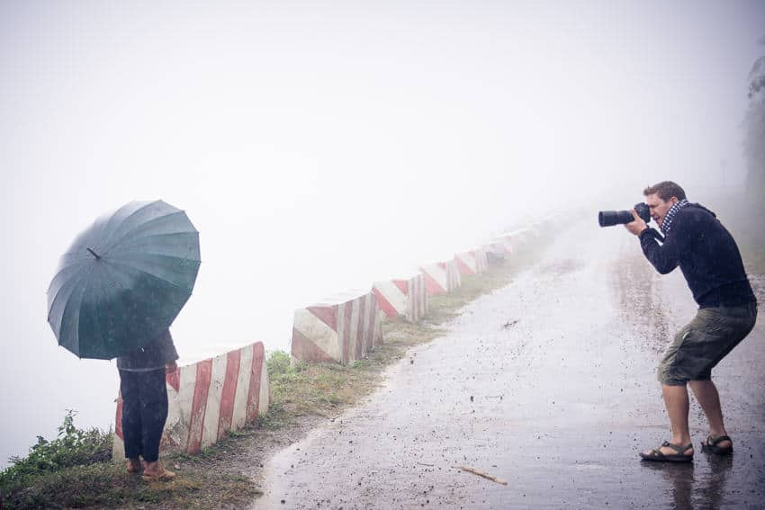 photographer Etienne Bossot taking photos in Vietnam