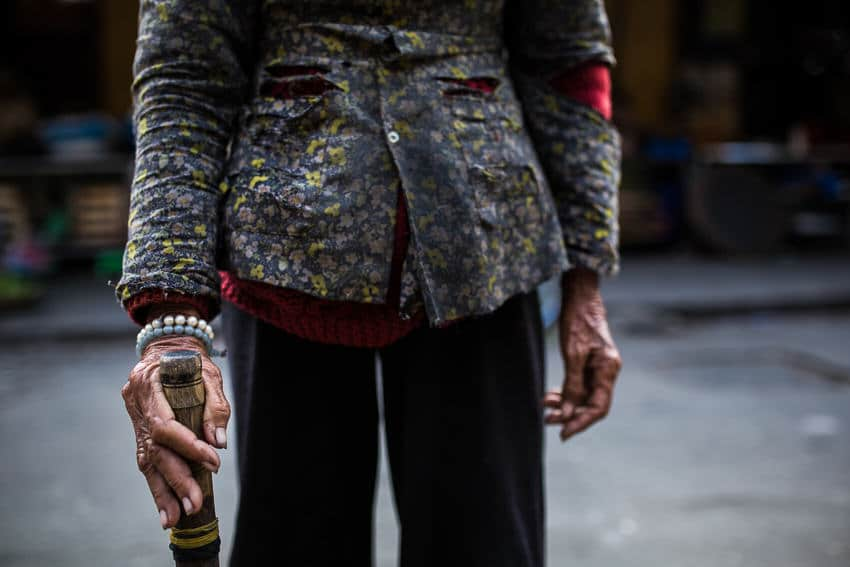 Creative travel photo composition featuring a local in Hoi An, Vietnam