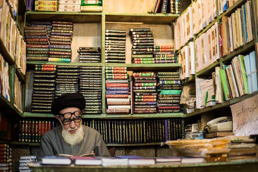 A mullah reading in a book store in Iran