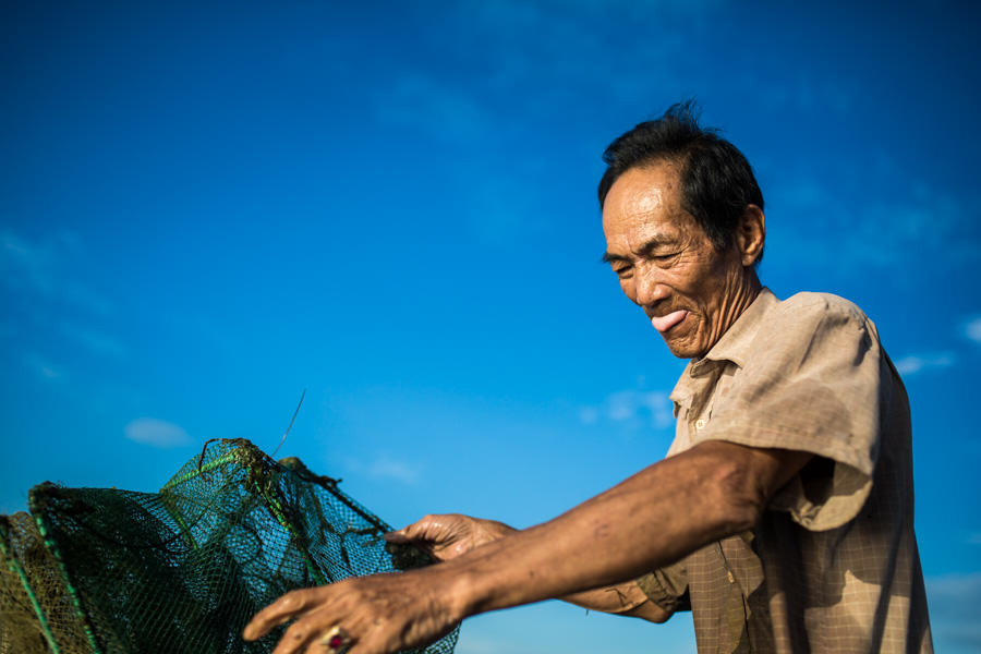 Fisherman pulling his net in Vietnam