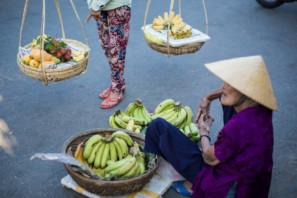 Two women selling bananas in the streets of Hoi An, Vietnam - Pics of Asia photo tour