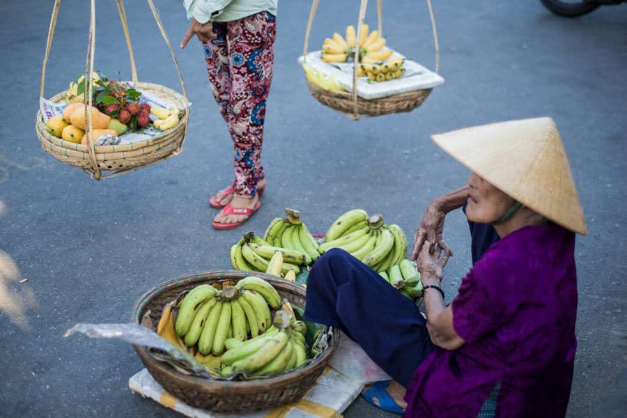 2 women selling bananas in the streets of Hoi An