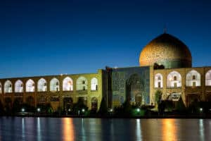 Isfahan, Iran at night with the mosque well light against the dark sky