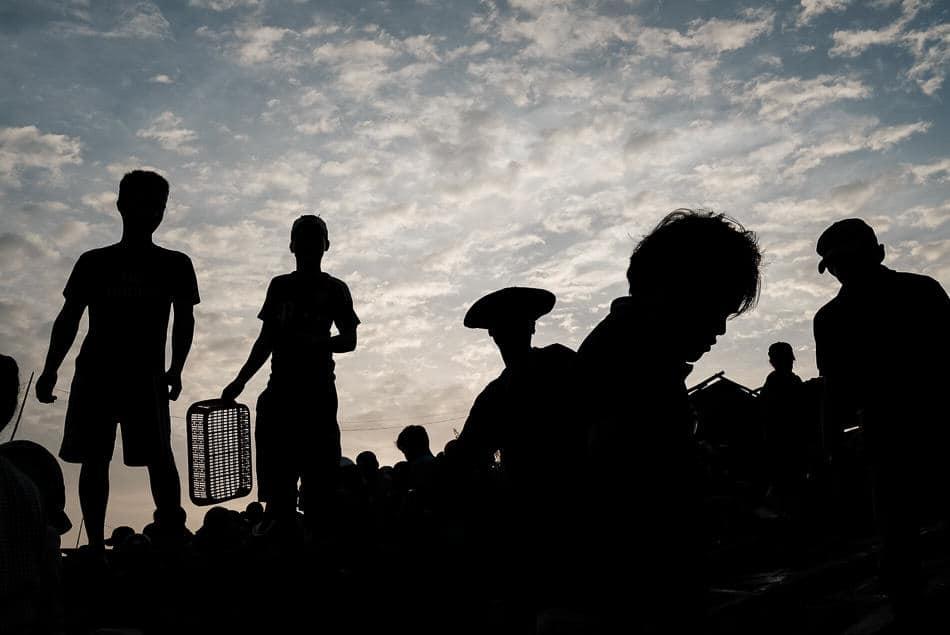 silhouette of Vietnamese fishermen