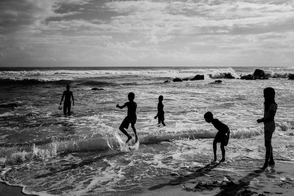 people playing in the water in Sri Lanka