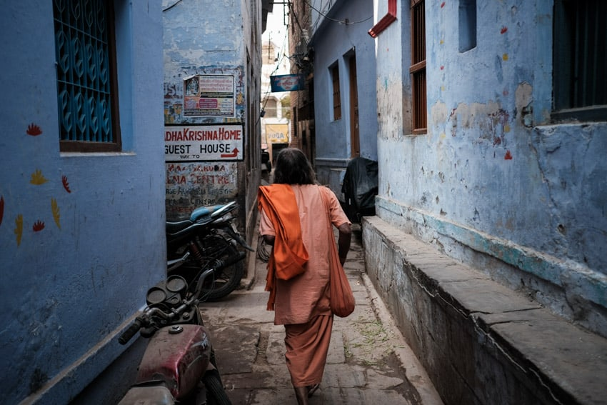 Sadu walking in the narrow alleys of Varanasi during a photography tour by Pics of Asia