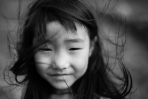 An up close portrait of Hmong girl in black and white taken in North Vietnam - Pics Of Asia Photos Travels Tours