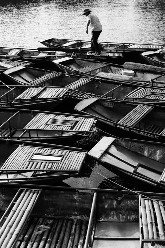 Bamboo Boats Fill The Rivers Of Nihn Binh in Black And White - Pics Of Asia Photos Travels Tours