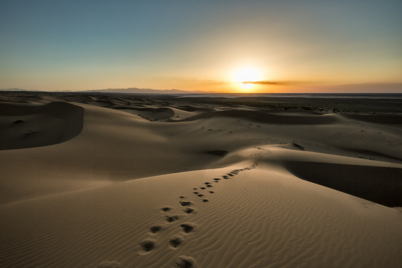 Footsteps on an empty desert sand dune as the sun sets in Iran - Pics Of Asia Phototours