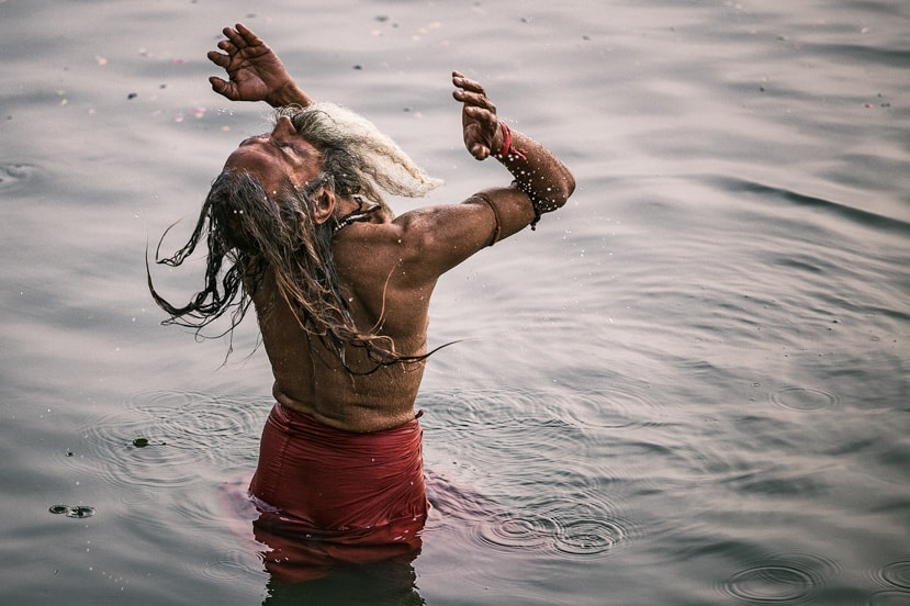 A prayer and purity as an monk prays in the Ganges River - Pics of Asia Tour Locations