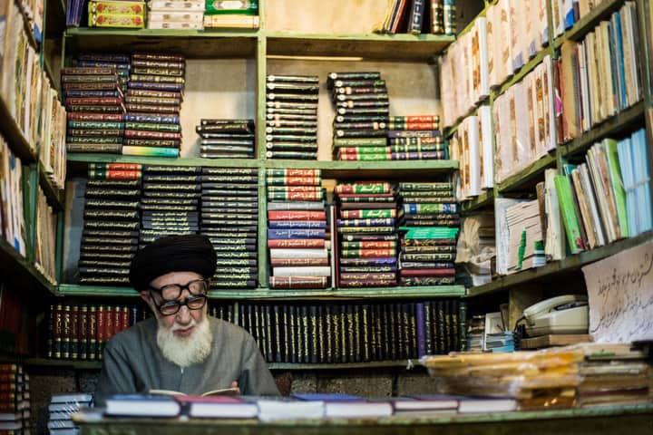 An elder reads in a small book store in Tehran Iran - Pics Of Asia Photography Tours