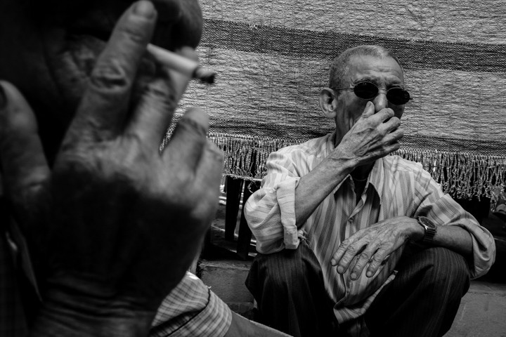 A man in glasses clears his nose in Nam Dinh Vietnam - Taken On Tour With Pics Of Asia