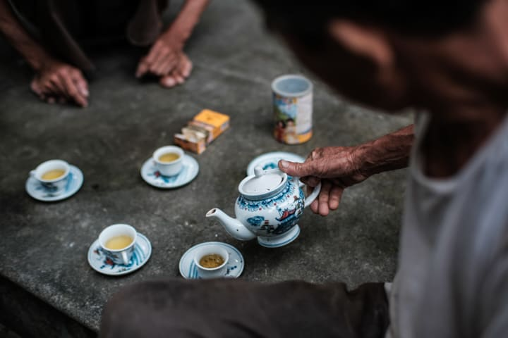 Old hands pour a local cup of tea in Nam Dinh Vietnam - Taken On Tour With Pics Of Asia